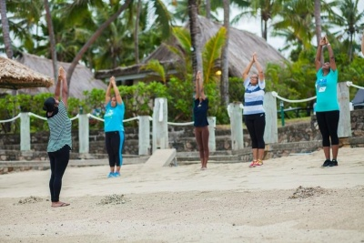 Bebe Spa Group stretch on beach GWD Fiji 2015.jpg