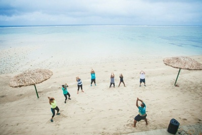 Photo Bebe Spa Group exercise on beach sea GWD Fiji 2015.jpg